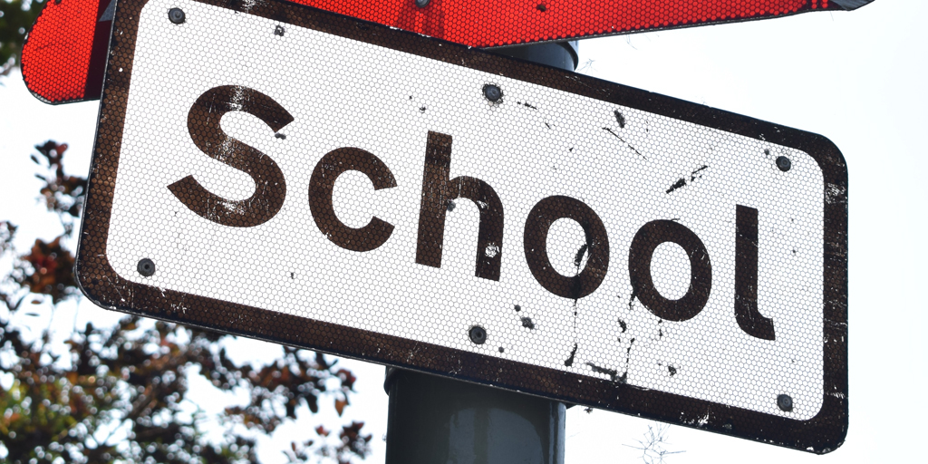 Photo of school road sign. Published under CC0 Public Domain. https://unsplash.com/photos/uq7q2hZQEEE